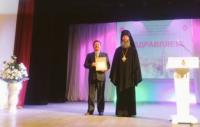 Награждение Архиерейской грамотой директора школы Пудова И.А на областных рождественских образовательных чтениях