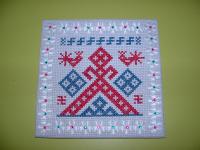 Вышивка салфетки с символами земли и урожая